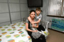 Kara Mitchell and her son Aaron, 11, in the bedroom where they barricaded themselves in when an intruder broke into the house