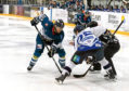 Dundee Stars' Johan Andersson takes the face-off with Milton Keyne Lightning's Kevin King