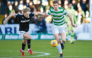 Dundee's A-Jay Leitch-Smith (left) with   Celtic's Kristoffer Ajer