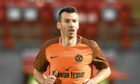 Paul Quinn in action for Dundee United