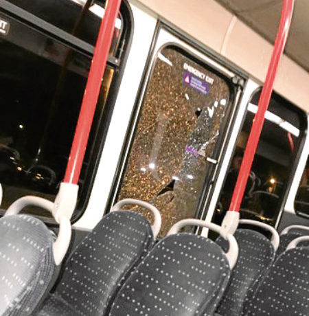 The smashed window of the route 17 Xplore bus in Pitkerro Road