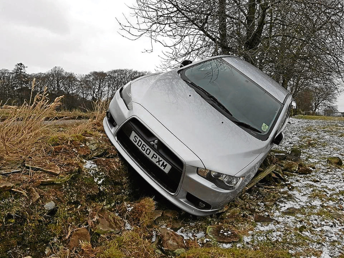 The Silver Mitsubishi that crashed off the road.