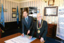 Council leader John Alexander and Lord Provost Ian Borthwick  signs the Global Covenant of Mayors for Climate and Energy.