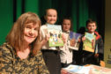 Author Julia Donaldson with some of the schoolchildren following the story-telling session at Dundee Central Library.