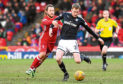 Dundee full-back Kevin Holt made his first start in over a month up at Aberdeen on Saturday. He couldn't prevent the Dons running out 1-0 winners and says the Dee need points quickly.