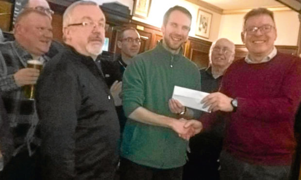 Robin, left, and Ray, right, handing over the £280 cheque to Michael Calder of Dundee Foodbank.