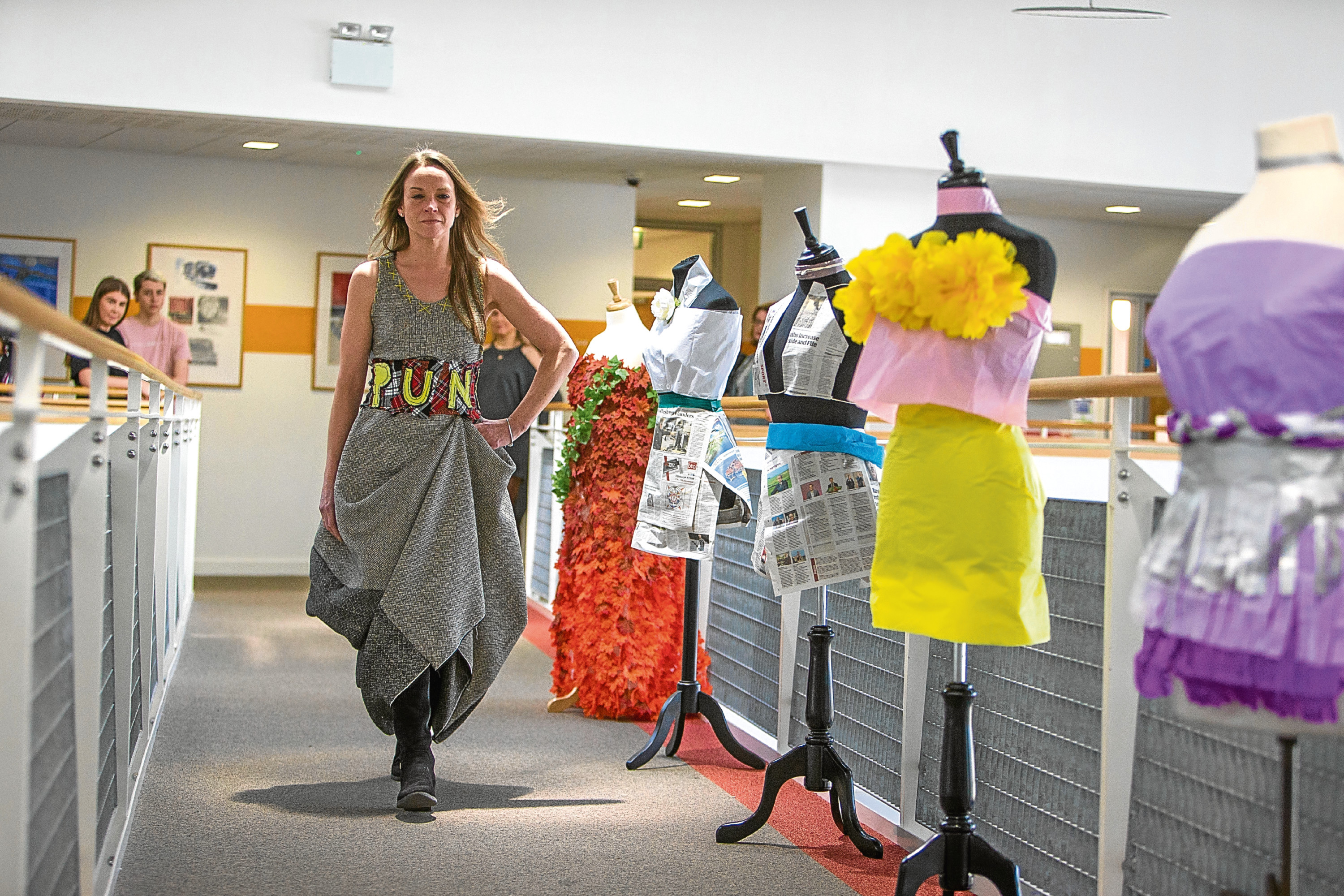 Donna Jackson models a dress for the catwalk made by fashion students at Dundee and Angus College.