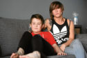 Terri Thornburn and her son, Finlay, who was bitten by a rottweiler.