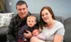 Dad Craig, Michael (2), Amy (1 week) and mum, Sarah Cargill.