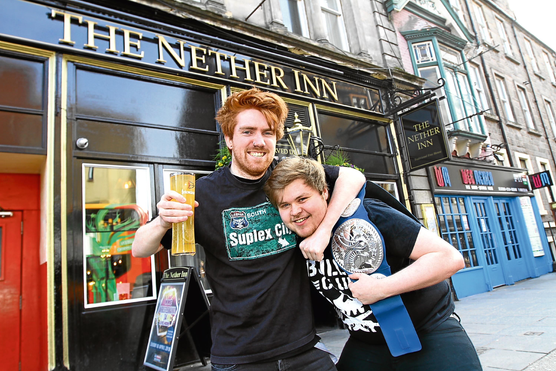 Nether Inn barman Graeme Robertson and duty manager Ryan Hanlon get into the grappling spirit.