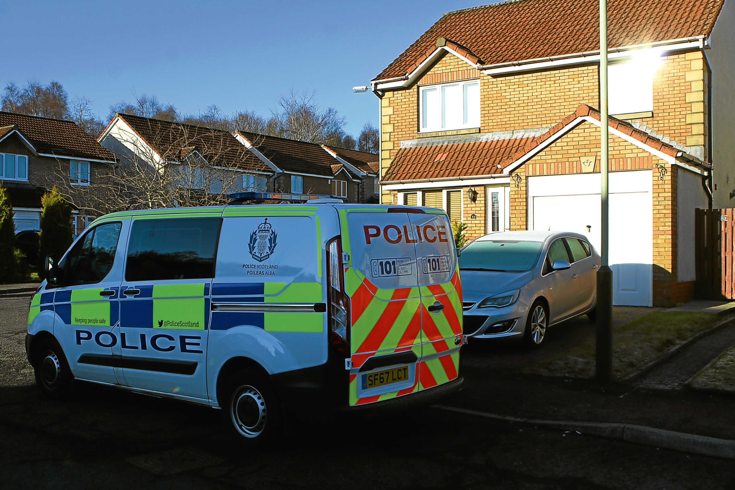 A police presence outside the property in Clattowoods Road