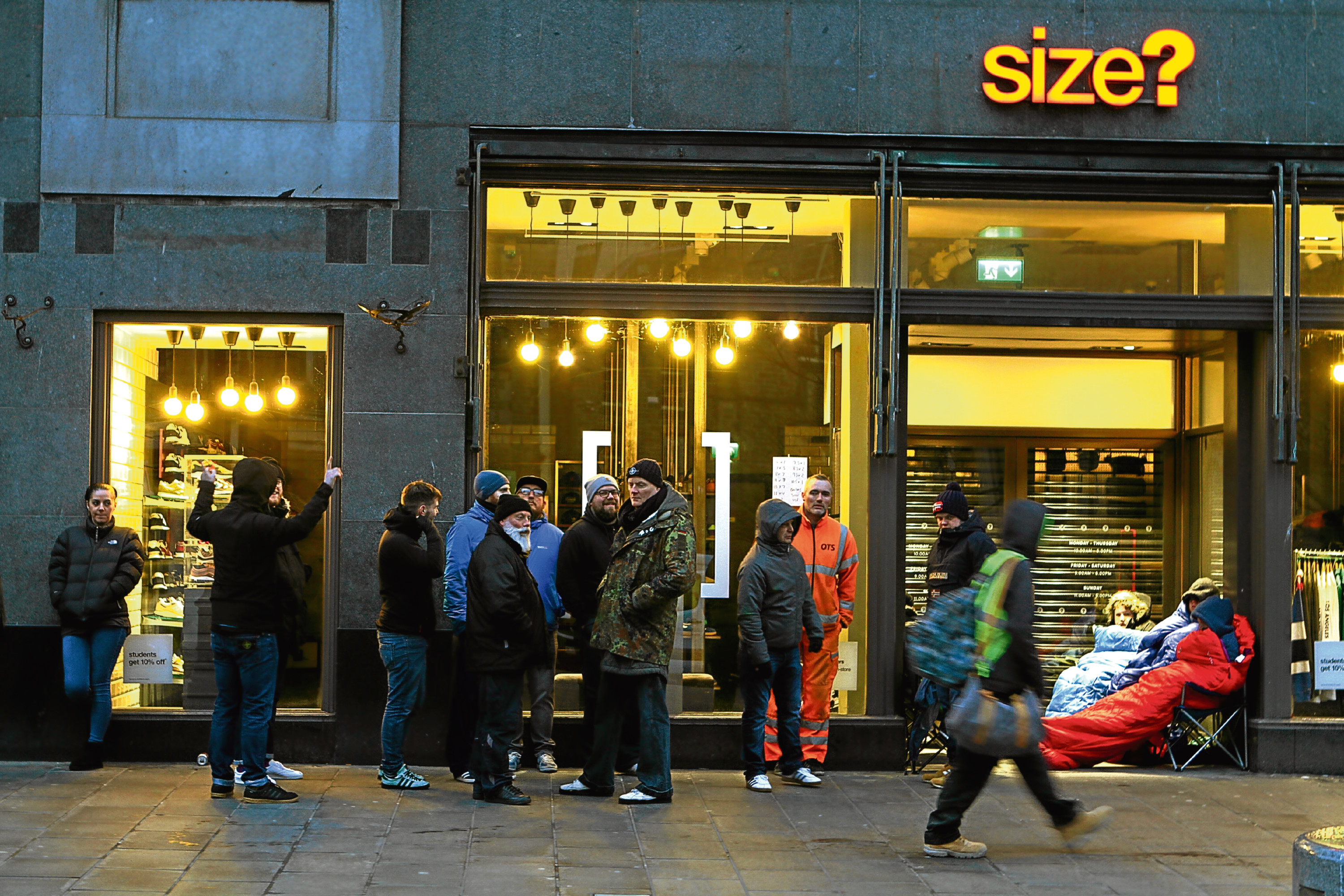 Eager Adidas fans queue outside Size? in Dundee High Street