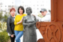 Irene Baxter, Jayne Kelly and Myles McCallum of the Village of Lochee Partnership, pictured at the Jute Women sculpture, have vowed to keep up the campaign.