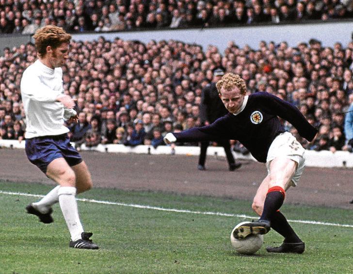 England legend Alan Ball up against Celtic and Scotland hero Jimmy Johnstone.
