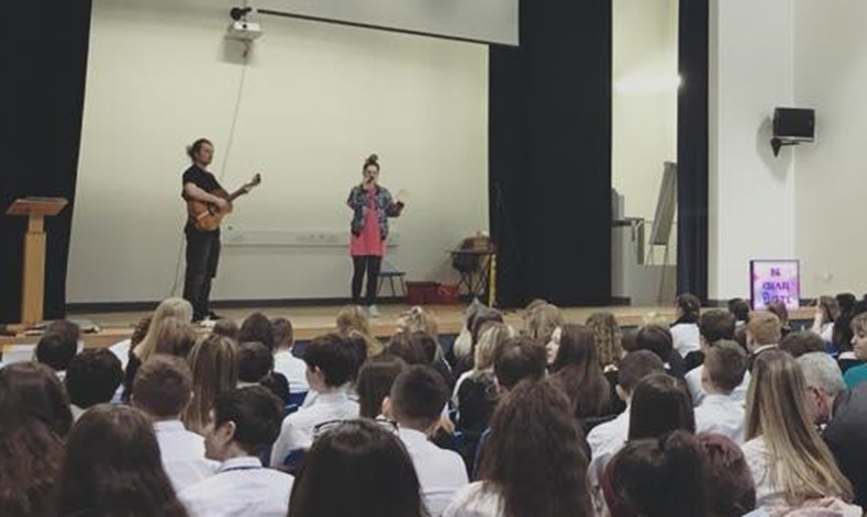 Be Charlotte on stage at St Paul's RC Academy