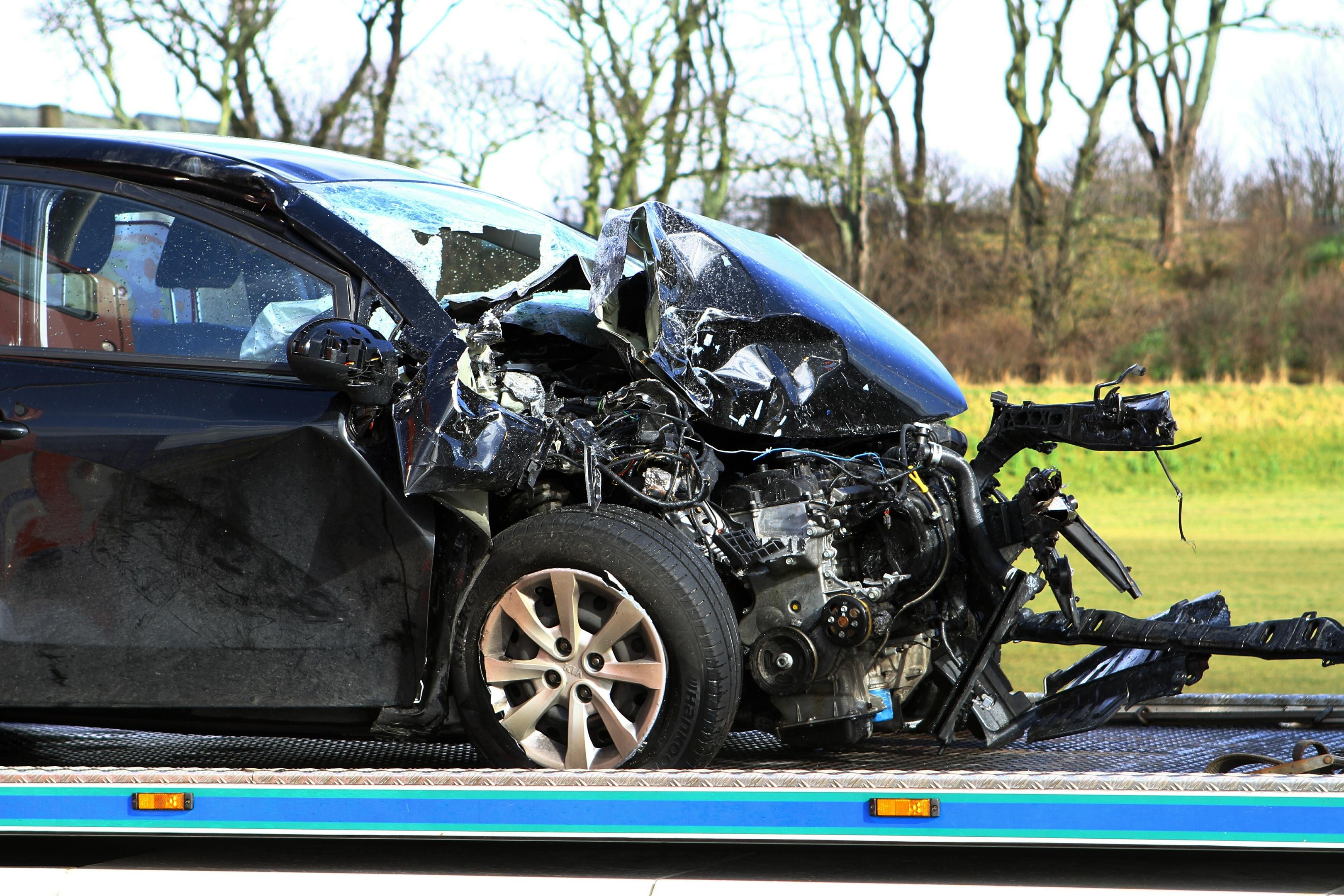 The black Kia Rio involved in the collision.