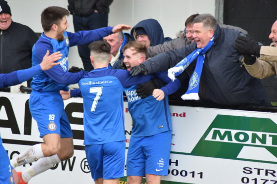 Lochee United's Connor Birse is mobbed by team-mates and fans after netting his hat-trick in the 4-1 win against Beith in the quarter-final.