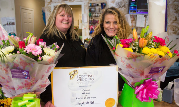 Forget Me Not Designer Florists owner and florist Dawn Falconer with florist Carrie Stewart.