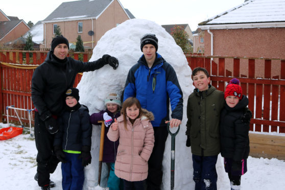 Sean Dillon and councillor Alasdair Bailey with some of the kids and their igloo.