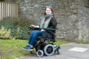 Judith in her new wheelchair