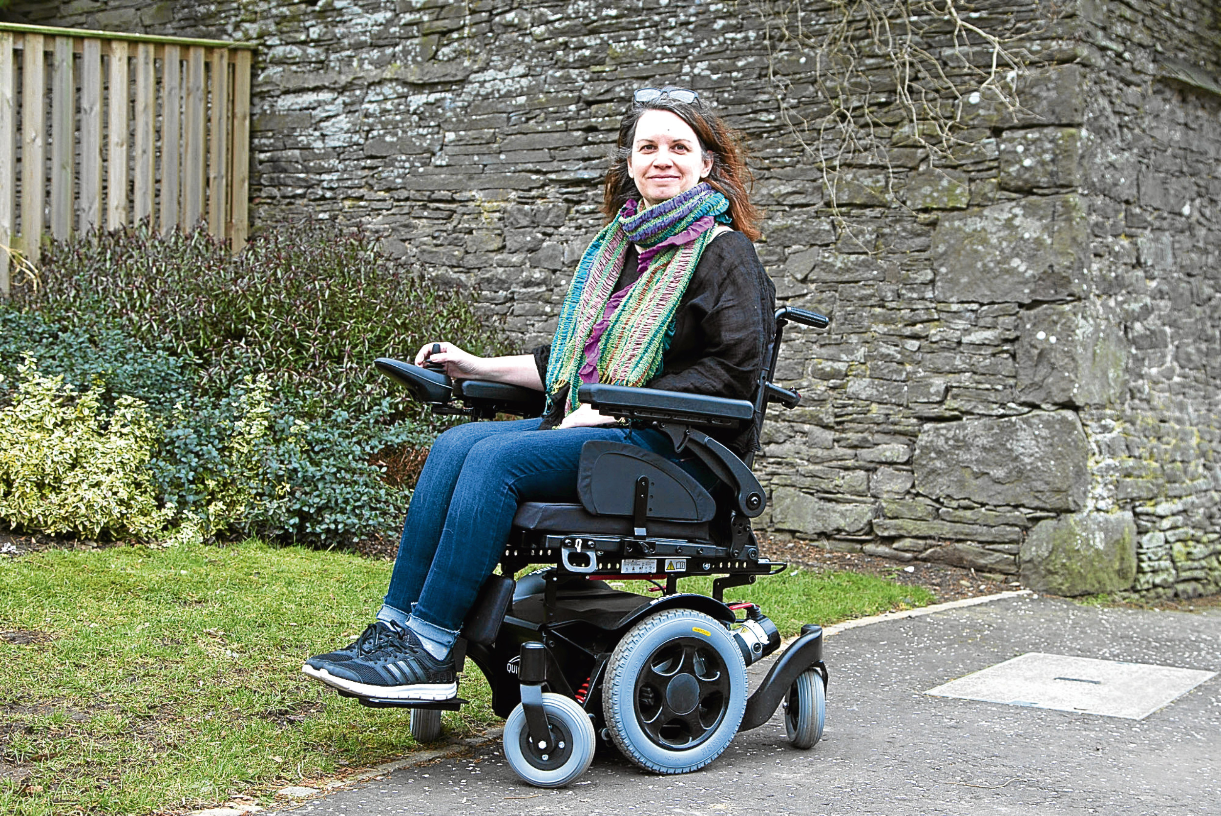 Judith in her new wheelchair