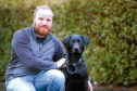 Ian Killoh is back at home with his beloved dog Diesel after the pair were involved in a collision with a drink-driver.