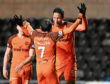Goalscorers Paul McMullan and Bilel Mohsni celebrate the latter's goal in Tuesday's 2-0 win over Dumbarton at Tannadice.