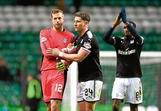 Josh Meekings and Elliott Parish celebrate a  valuable point at Parkhead.