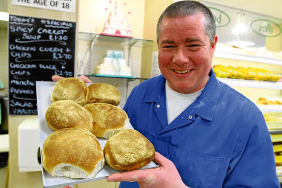 Bakery manager Steven Hirons with some well-fired rolls, at Nicoll's Bakery in Dundee