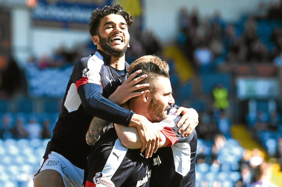 Faissal El Bakhtaoui celebrates with Marcus Haber as Dundee stayed up last season with victory at Kilmarnock eventually enough to see them safe.
