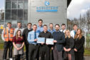 Picture shows DYW employment liaison officer Ross Paterson (centre) presenting certificates to Mr Blyth (left) and Andrew Strachan (right), principal teacher of guidance at Baldragon Academy, watched by the pupils and their mentors.