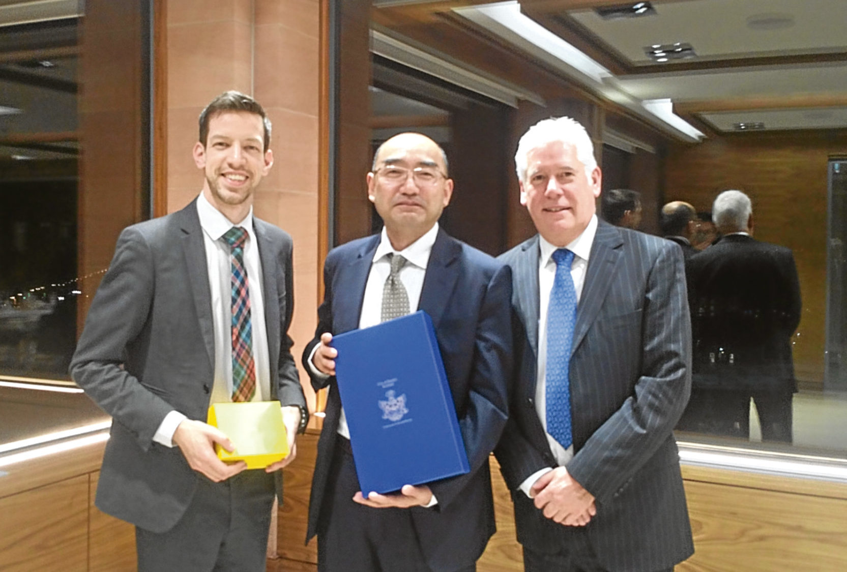 John Alexander with COES vice-president Jiang Yan and Callum Facolner, chief executive of DundeeCom.