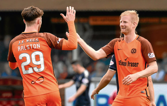 Dundee United manager Csaba Laszlo reserved special praise for the recent performances of Danish striker Thomas Mikkelsen (right).