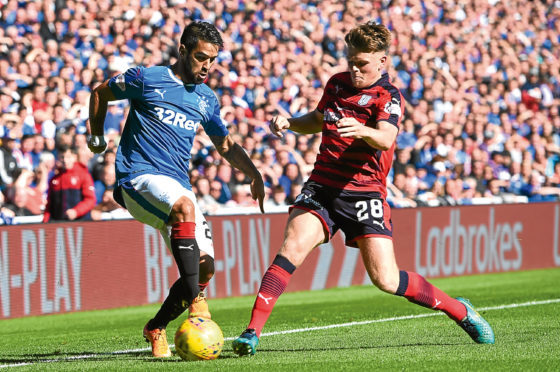 Battling midfielder Lewis Spence has impressed for Dundee in recent showings at both Celtic Park and Ibrox at the start of this month and has featured 18 times this season.