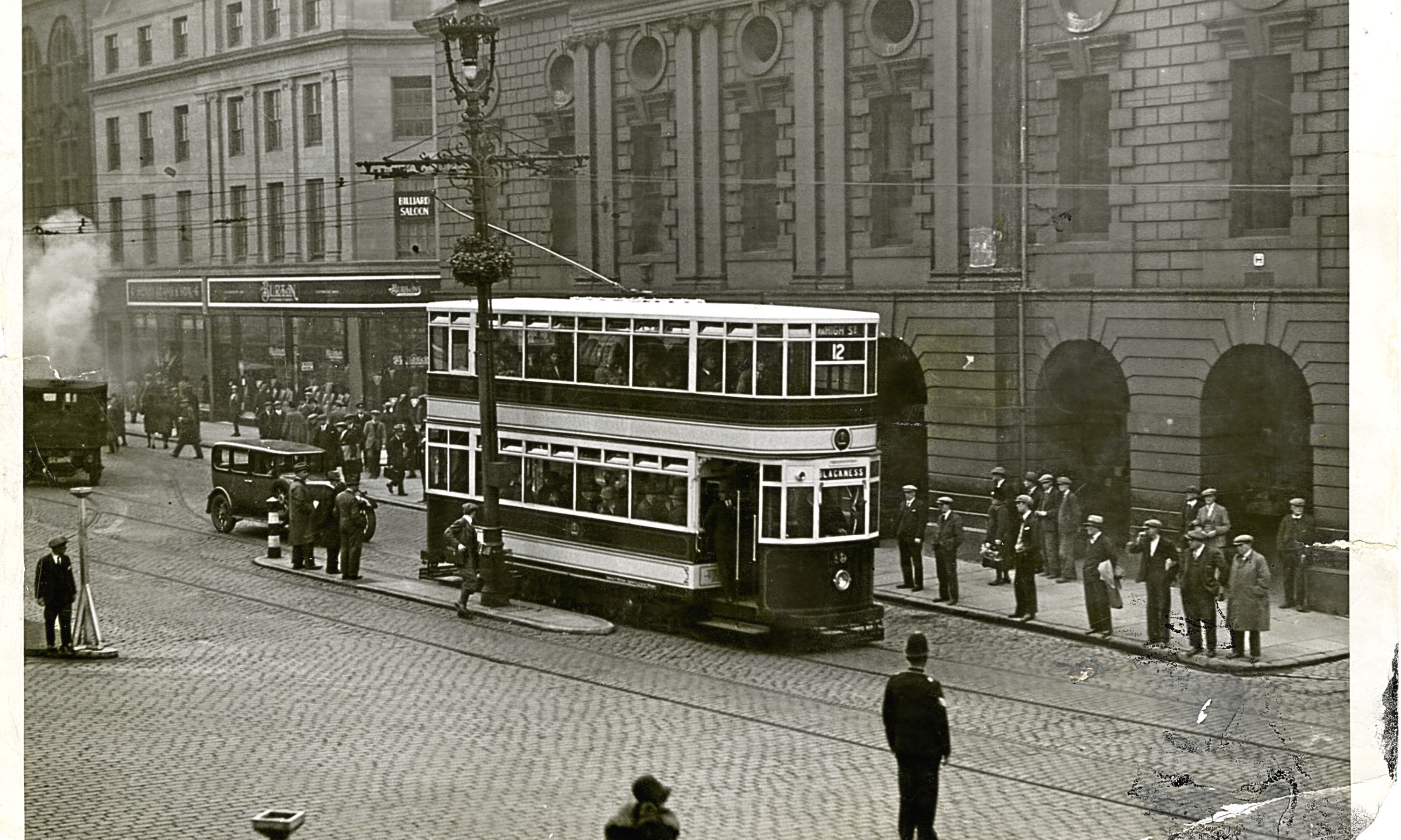 A new Dundee Tram stopped somewhere in Dundee City Centre.