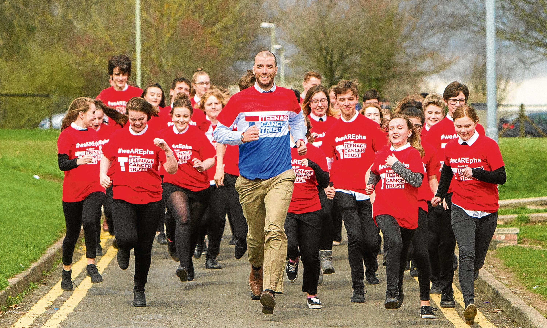 More than 100 pupils are taking part in sponsored runs for Teenage Cancer Trust, inspired by Chemistry teacher and London Marathon runner Dr Stephen Jones.