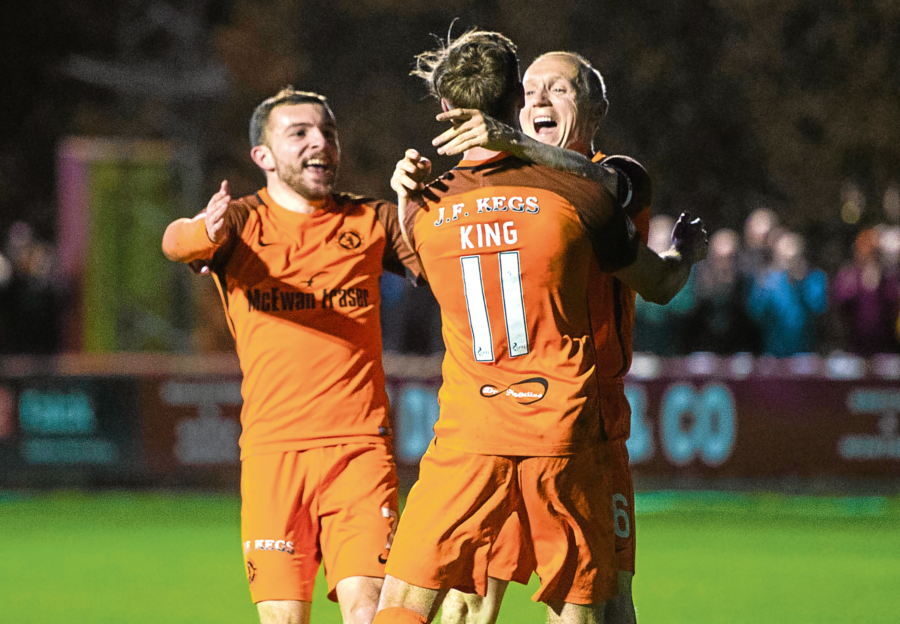Paul McMullan and Willo Flood congratulate scorer Billy King's second goal for United at Brechin on Tuesday.