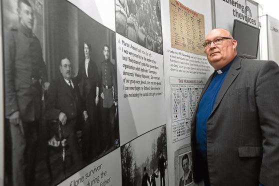 Rev Michael Allardyce beside an exhibit