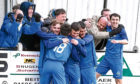 Fans celebrate as Lochee United went 4-1 up against opponents Beith Juniors FC in the quarter-final of the Scottish Junior Cup.