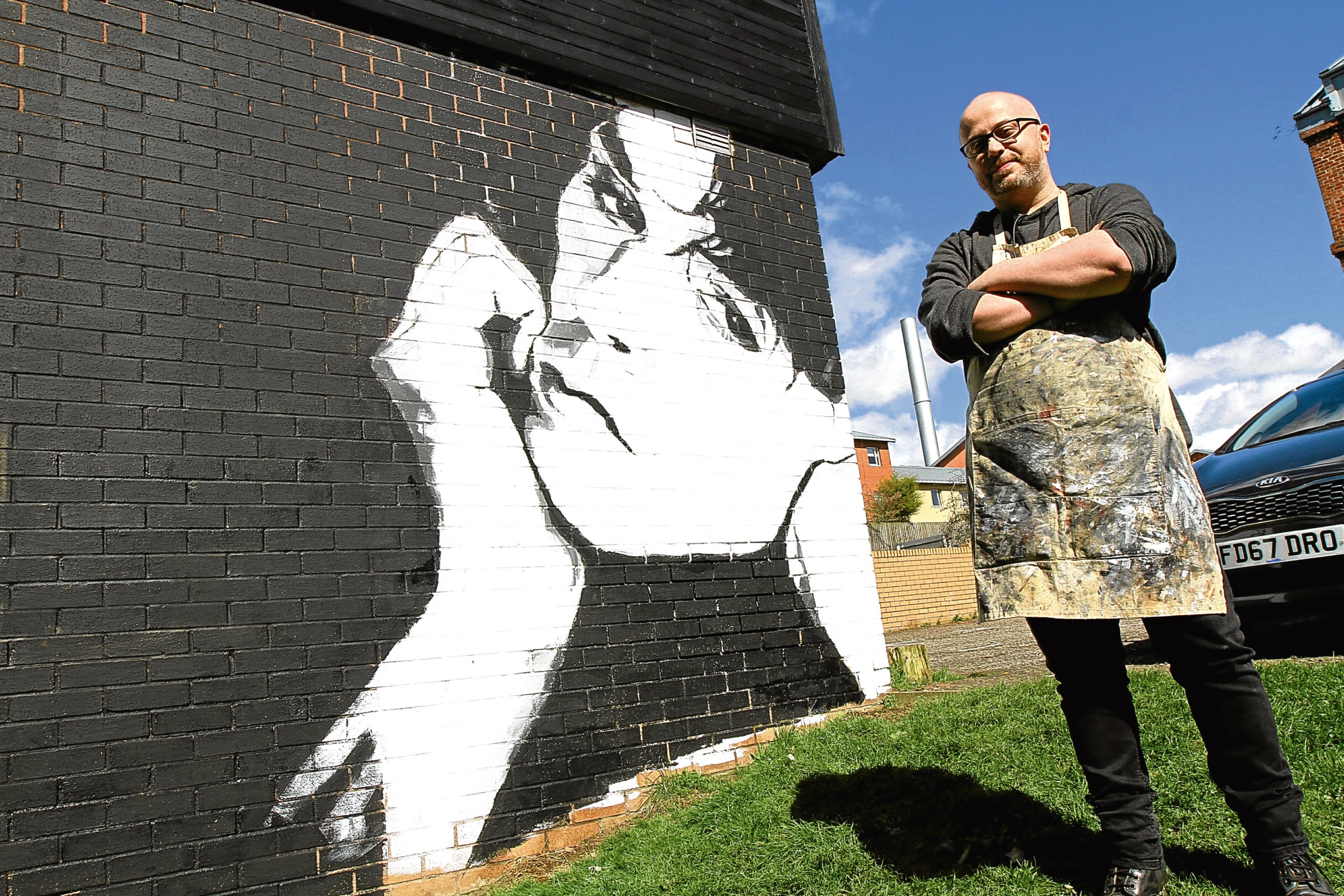 Artist Garry Milne in front of his stunning portrait of Billy MacKenzie, at the Boomerang Centre in Stobswell.
