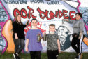 Donna Morland (left) , Evie Will, 11, Donna's son Aaron, 6, and project manager Pamie Bennett (right)l in front of the new mural.