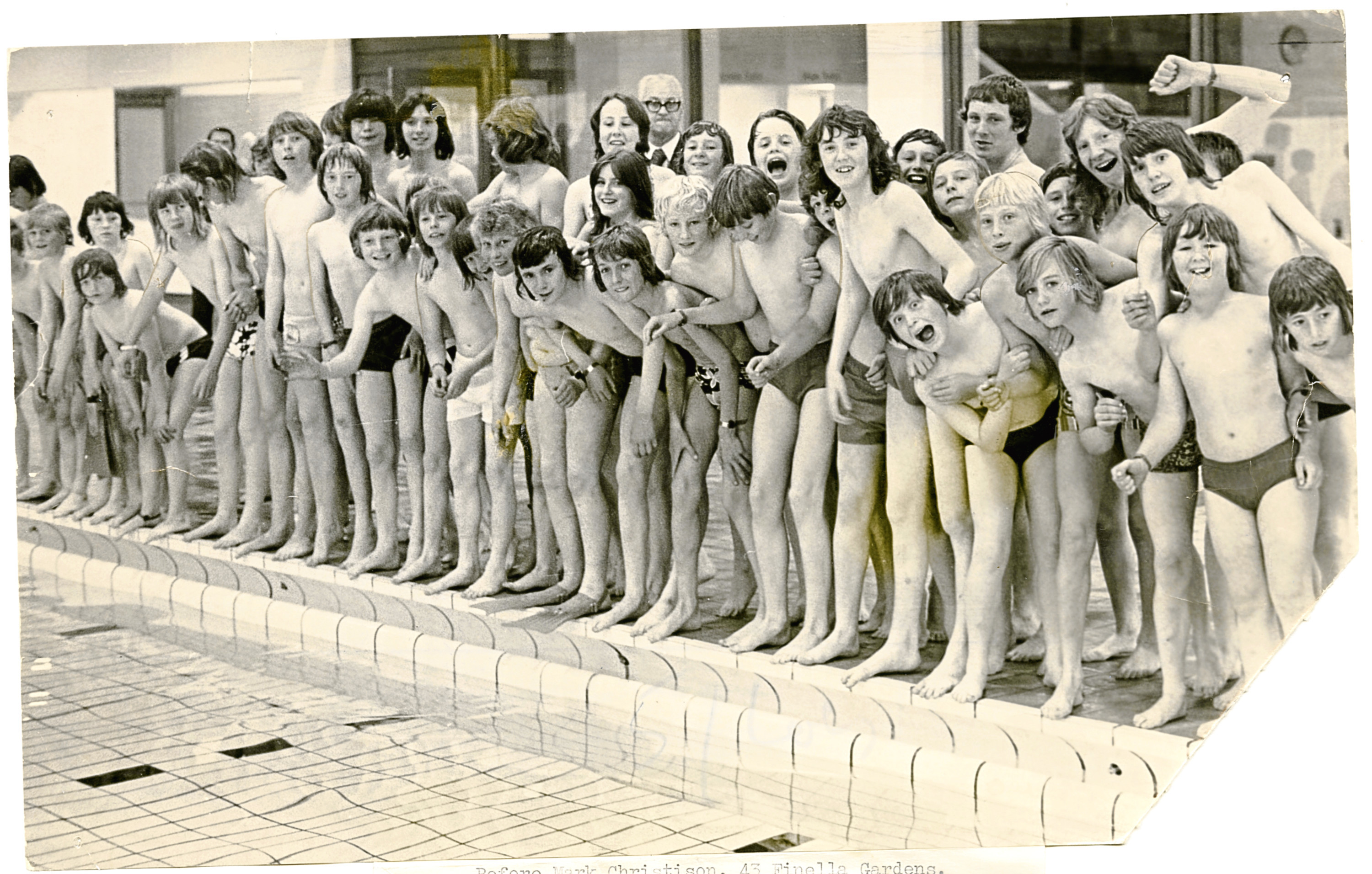 Boys Group at Dundee Baths. Photograph showing a group of boys at Dundee Swimming Baths, eagerly awaiting to jump in the pool. July 1974. H250 1974-07-00 Boys Group at Dundee Baths (C)DCT Dundonian. Used in T&P 15 July 1974, 8 July 1999.