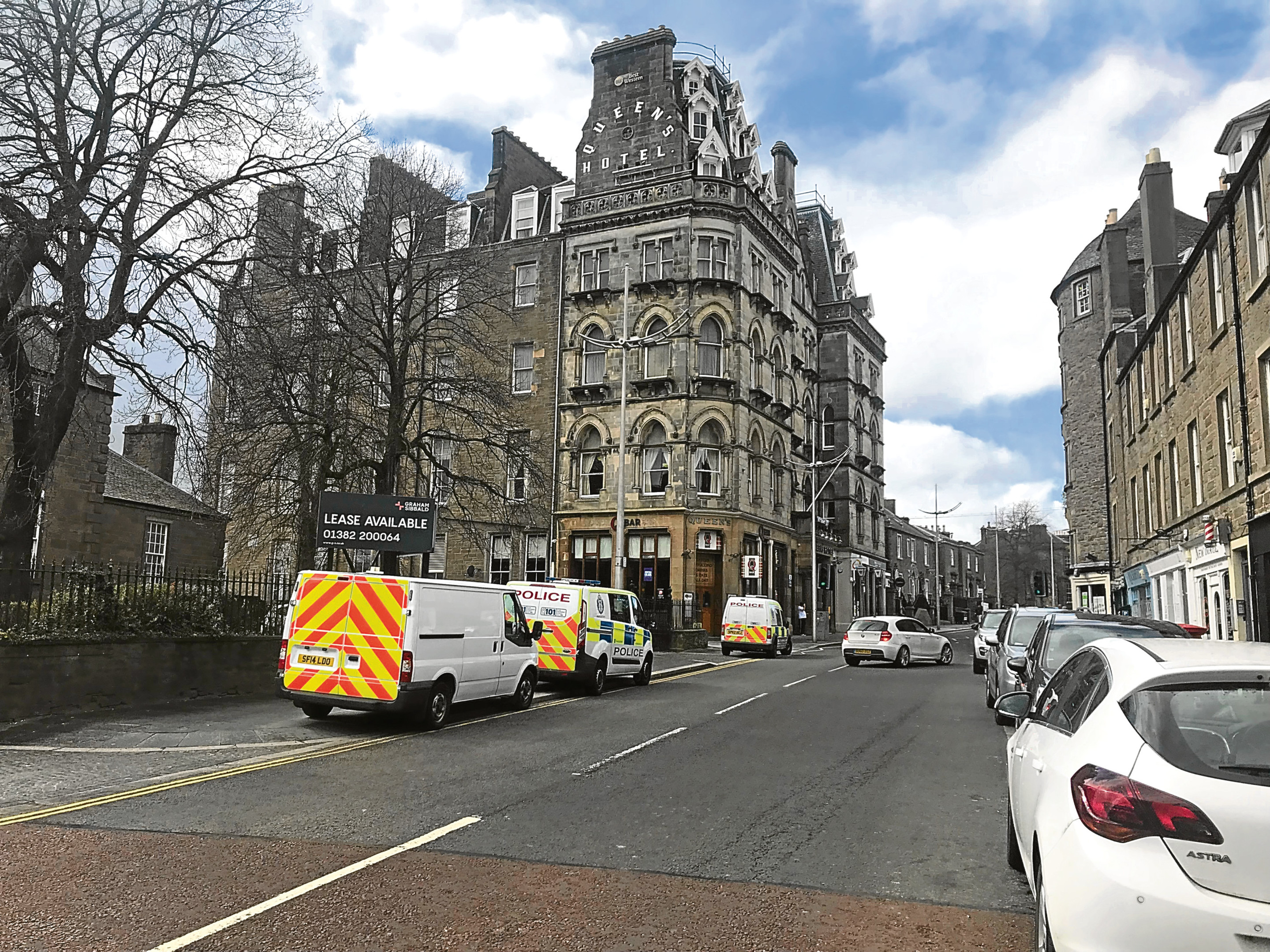 Police officers outside the Queen's Hotel at the Nethergate.