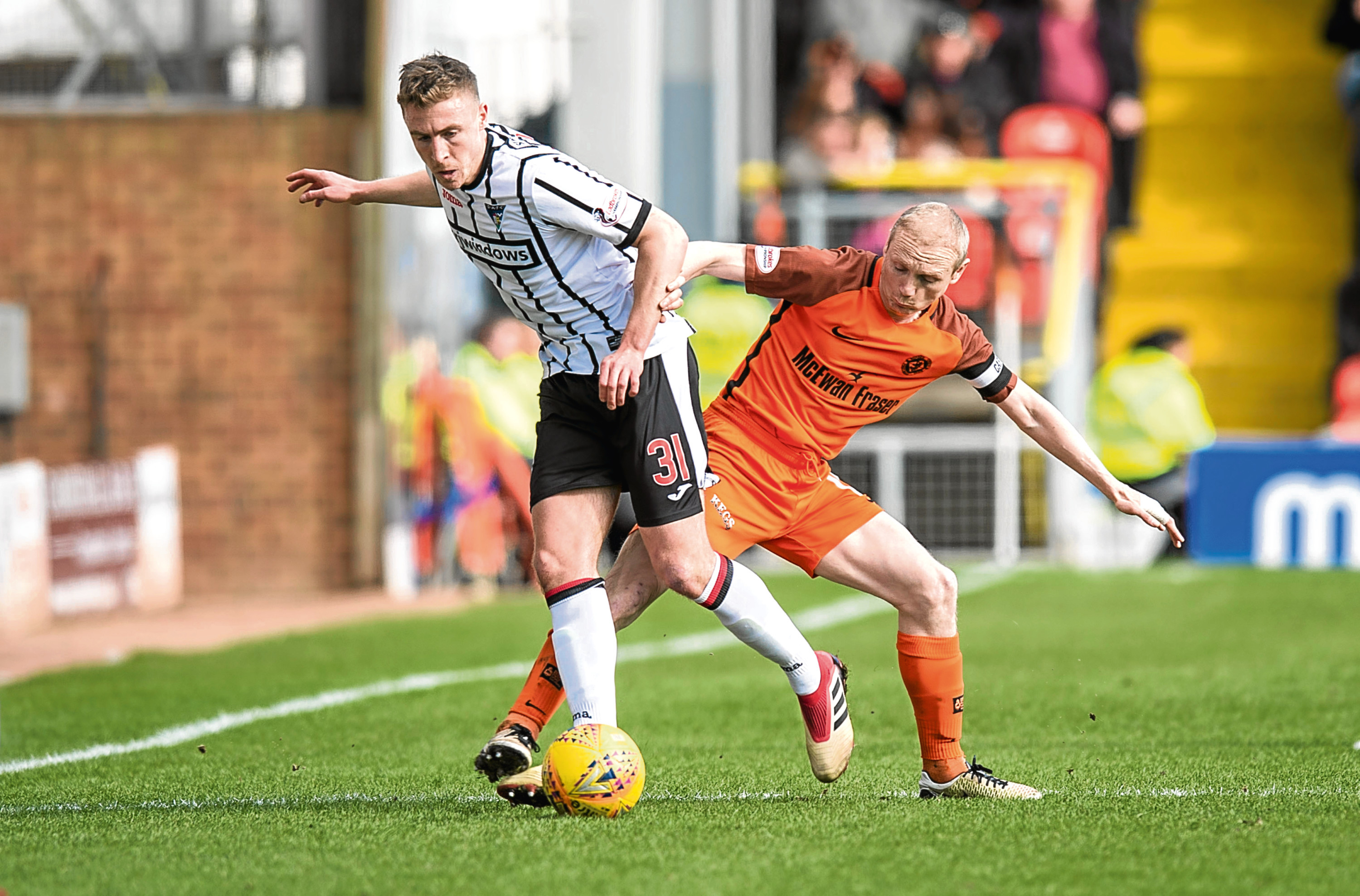 Dundee United midfielder Willo Flood is one of the three players walking a suspension tightrope as the Tangerines get ready for the play-offs.