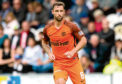 Dundee United striker Scott McDonald wants to lead the team through the play-offs.