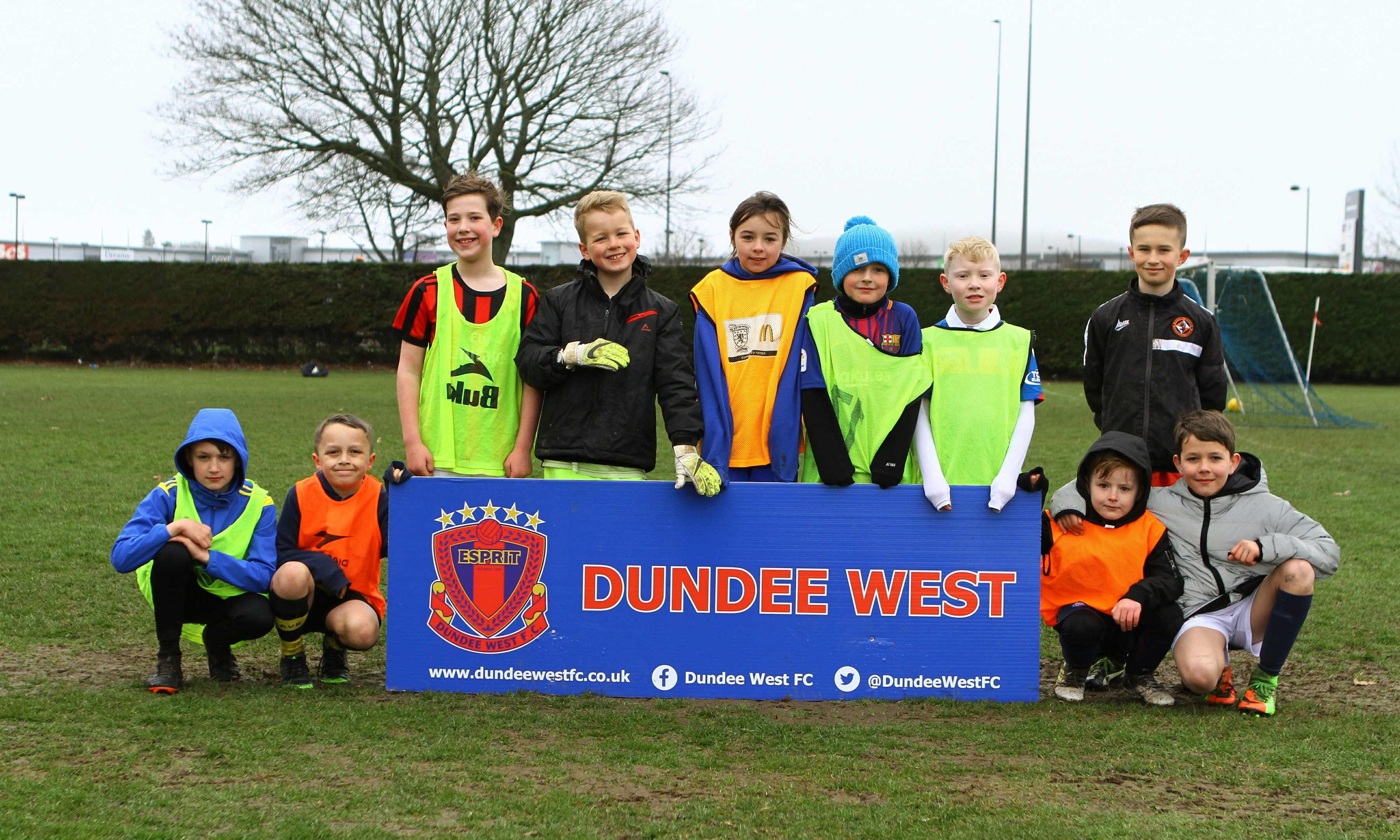 The 8 to 12 year old group pose for the camera, at the Dundee West FC Easter Holiday Football Camp, at Charlotte Park in Dundee.