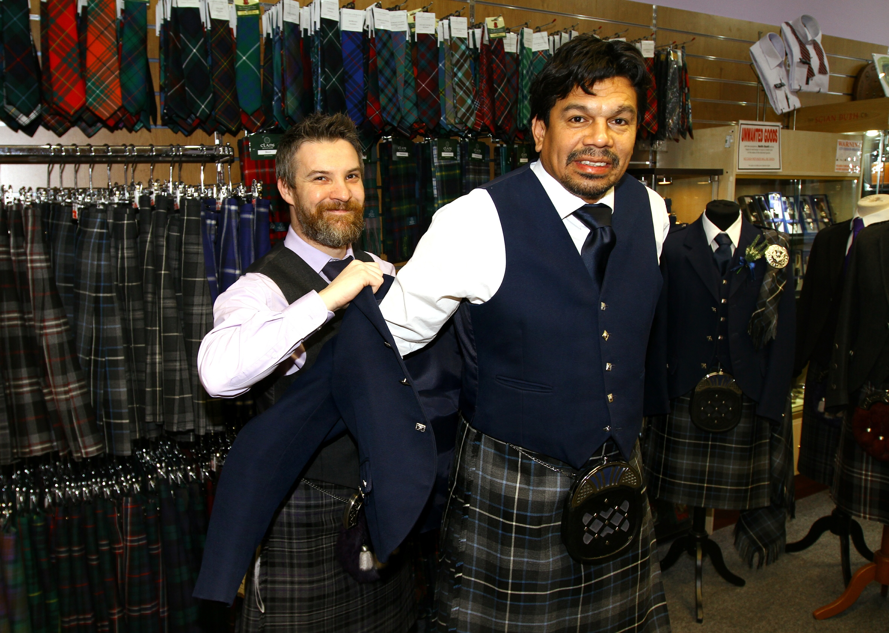 Paul Daly, manager at Keith Scott Kilts kits out Dundee legend Fabian Caballero.