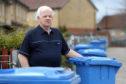 Peter Gow beside the paper bins at Hazelhead Drive.