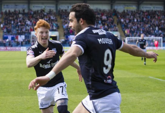 Simon Murray goes to celebrate with Sofien Moussa after the Tunisian opened the scoring for Dundee