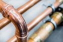 Brilliant new copper pipes. Connection of copper pipes blooming fitting. plumbers, gas,